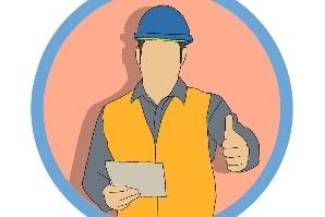 Bauarbeiter mit Papierstück in der Hand